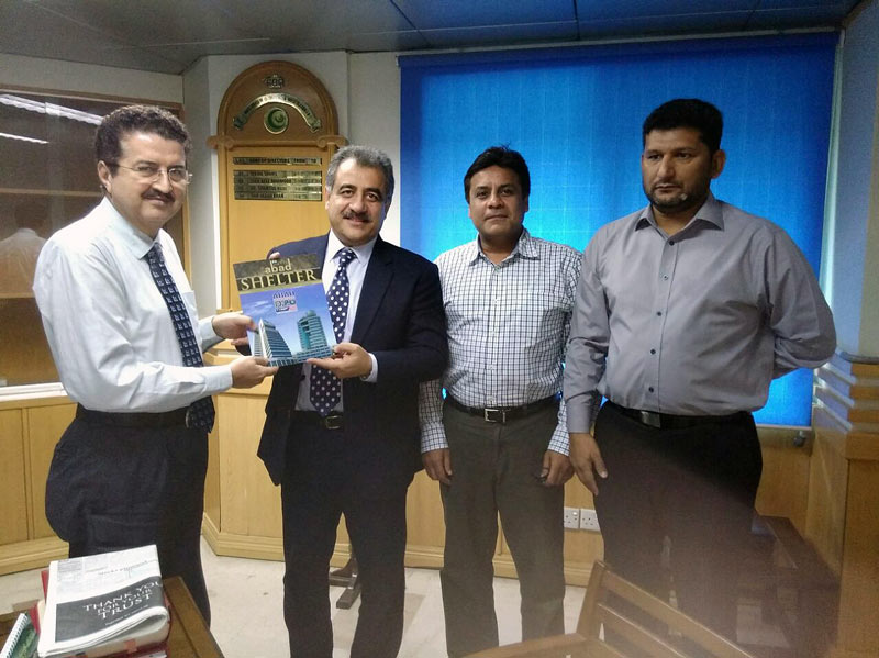 Mr. M. Hanif Gohar, Chairman ABAD Presenting Shelter Magazine of ABAD to Mr. Saifullah Khanm Director FBR, East Zone, Mr. Mohsin Sheikhani, Former Chairman ABAD and Mr. Ibrahim Habib, Convener of Legal Affairs Sub-Committee of ABAD also present